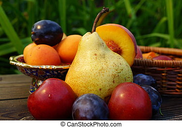 Summer fruits: pear, peach, plum, apricot - Still life with...