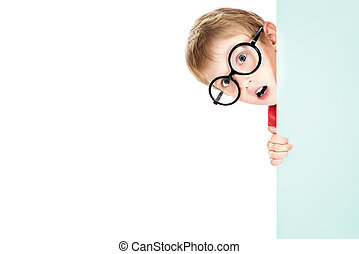 peeking around - Portrait of a cute boy in spectacles...