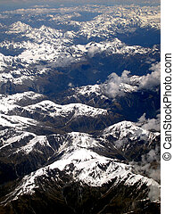 Mountain Range, New Zealand - Aerial view of a snow topped...