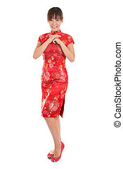 Chinese cheongsam female greeting - Full length Asian woman...