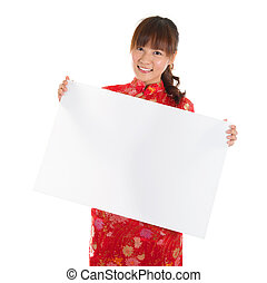 Chinese cheongsam girl holding placard - Asian woman with...
