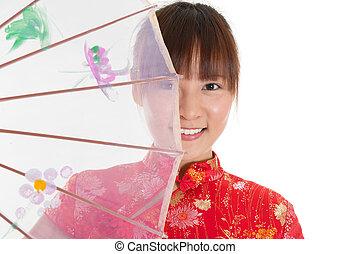 Chinese cheongsam girl with umbrella