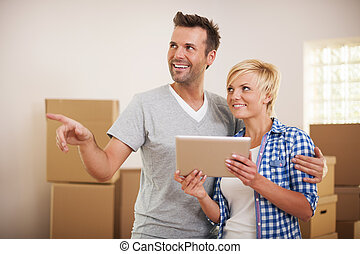 Couple arranging their house after moving in