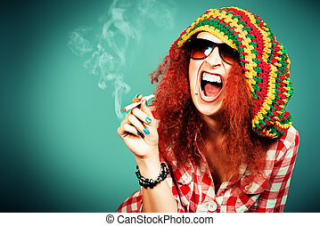 addiction - Portrait of a smiling Rastafarian girl.