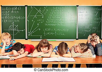 sleeping tales - Group of tired school children at a...
