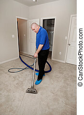 Carpet steam cleaning - Man cleaning carpet with commercial...