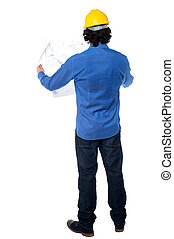 Construction worker with blueprint plan - Young male civil...