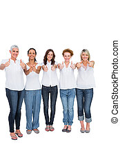 Cheerful casual models with thumbs up on white background