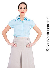 Serious classy businesswoman posing on white background