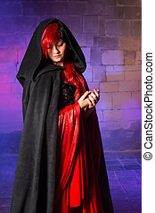 Vampire beauty - Gorgeous young vampire woman standing in a...