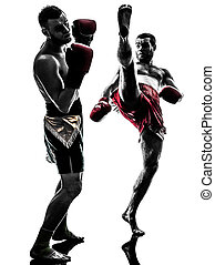 two men exercising thai boxing silhouette - two caucasian...