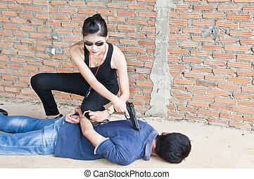 Suspect under arrest by policewoman