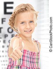 girl with optical eye chart