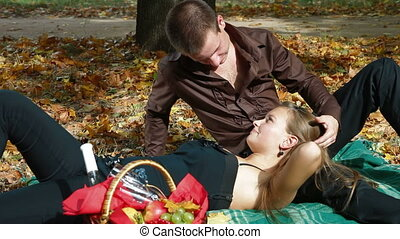 Happy teenage couple at picnic in the autumn park