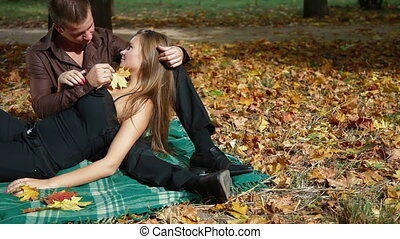 Autumn day in the city park - Loving couple at picnic in the...