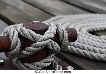 Cleat and rope closeup - A cleat tied off with a boat line