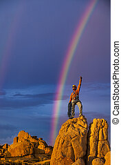 Climber on the summit. - Climber celebrates success and a...