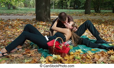 Couple at picnic in autumn - Young couple enjoying picnic in...