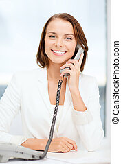 businesswoman with rotary phone calling - business and...
