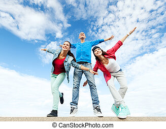 group of teenagers spreading hands - sport, dancing and...