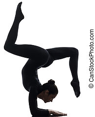 woman contortionist exercising gymnastic yoga silhouette -...