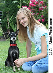 Smiling teenage girl with her dog