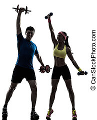woman exercising fitness workout with man coach - one woman...