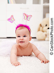 Butterfly princess crawling - baby girl on the floor