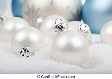 white christmas balls on snow