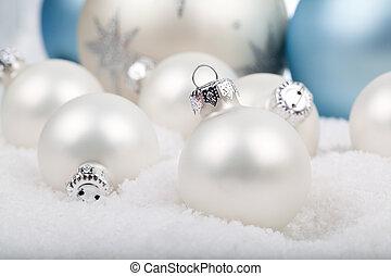 white christmas balls on snow