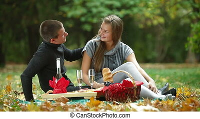 Couple at romantic picnic in autumn