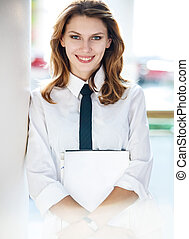 Young woman holds folders