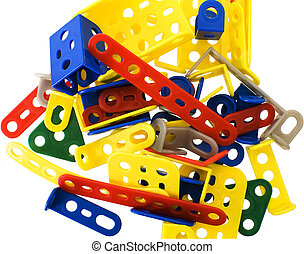 Meccano - A bunch of colorful detail meccano on a white...
