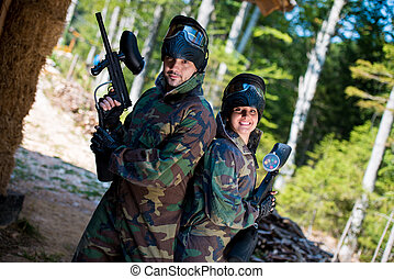 Paintball players posing to the camera - Paintball sport...