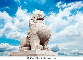 Stone Lion sculpture, symbol of protection & power in...