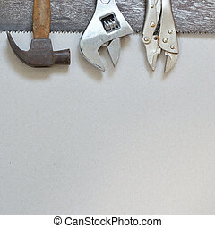 Work tools on gray recycled paper background.