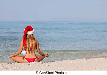 relaxing beach christmas vacation - relaxing woman at beach...