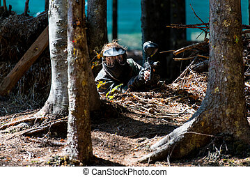 Paintball Player Hide Behind Tree - Happy paintball sport...