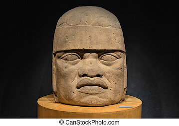 Stone Carved Olmec Head - An Olmec colossal head sculpted...