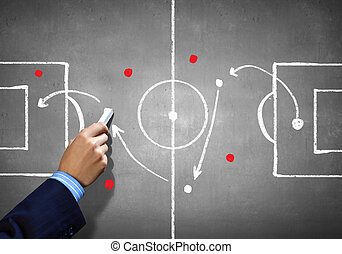Soccer game strategy - Close up image of human hand drawing...