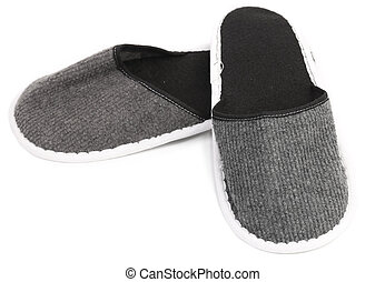 Pair of gray slippers on a white background.