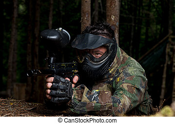 Sniper Aiming Gun - Paintball sport player in protective...