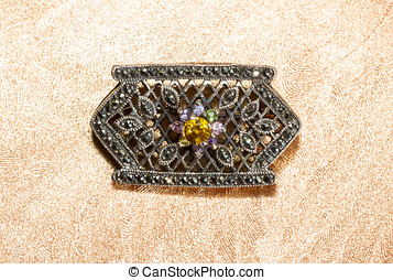 Marcasite brooch with central gemstone set with small...