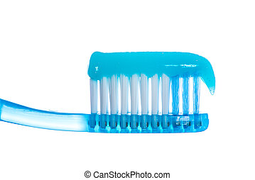 One toothbrush with toothpaste over white background. Studio...