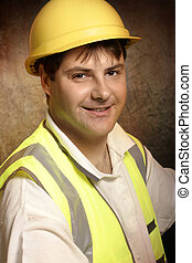 Confident builder in work clothes smiling