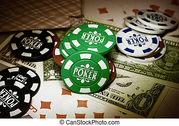 Playing cards, gambling chips and dollars