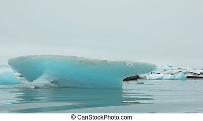 boat sailing through iceberg - expedition dinghy boat...