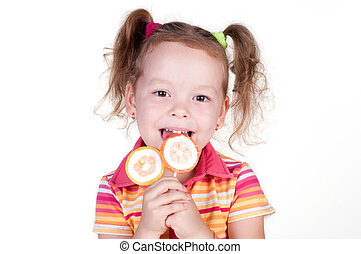 Cute fun little girl holding lolly pop on white background