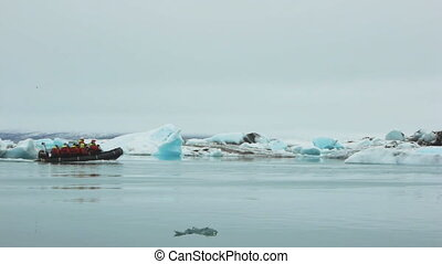 boat sailing through iceberg pan - expedition dinghy boat...