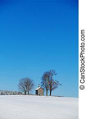 Solarcell - little wooden chapel in a beautiful snowy winter...